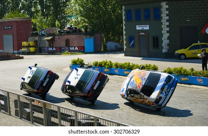 "RIMINI, ITALY, JULY 28,2014 Stuntmans performs a trick on daily view ""Police school"" at the amusement Park Mirabilandia"