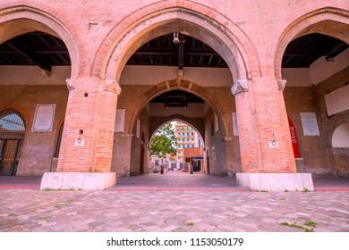 Rimini, Italy - June 13, 2018: Historic buildings on Square of the Three Martyrs in Rimini. Historic square of Rimini in the morning.