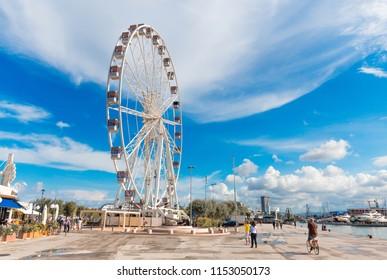 Rimini, Italy - June 14, 2018: Attractions. Rimini Ferris wheel on pier.