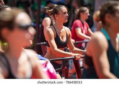 Rimini, Italy - june 2017:  Girl in Sportswear Exercising Outdoor on Treadmill.