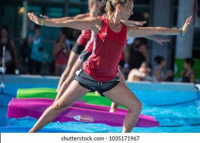 Rimini, Italy - june 2017: Girls Doing Exercises on Floating Fitness Mat in an Outdoor Swimming Pool.