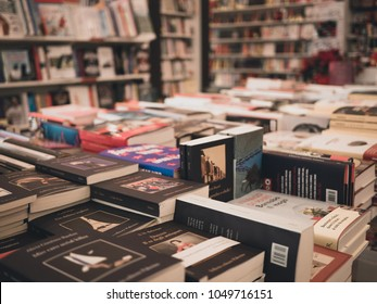 Rimini, Italy- March 09, 2018 new books are on large shelf in bookshop