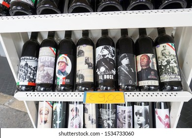 RIMINI, ITALY, SEPTEMBER 23, 2019. Wine bottles with labels featuring Benito Mussolini sold as souvenirs
