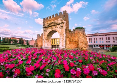 Rimini landmark. Italy. Famous Triumphal Arch in Rimini on blue sky background.