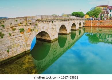 Rimini,Italy,7 april 2019.The Bridge of Tiberius (Ponte di Tiberio)is a Roman bridge in Rimini. Construction work started during Augustus' reign and was finished under his successor Tiberius in 20 AD