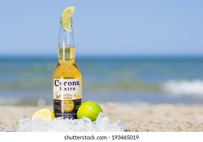 Rimini,rivazzurra,It. May 18, 2014. Corona bottle on the beach.Corona Extra is a pale lager produced  in Mexico for domestic distribution and export to all other countries besides the USA.