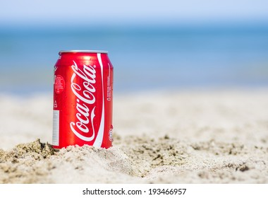 Rimini,Rivazzurra,IT. May 18,2014.Coca cola can on the beach.Coca-Cola is a carbonated soft drink sold in stores, restaurants, and vending machines throughout the world.
