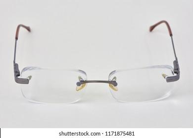 Rimless eye-glasses on white background.