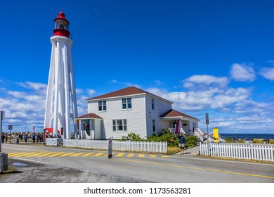 RIMOUSKI, CANADA - AUGUST 16, 2017: Pointe-au-Pere (Father Point) lighthouse along with the Site historical maritime de la Pointe-au-Pere museum are major regional tourist attractions.