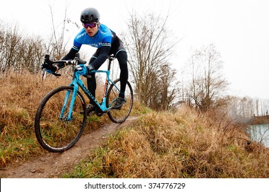 RIMSINGEN, GERMANY - February 7: Cyclocross competitors race against each other during a racing simulation in Rimsingen, Germany on 02/07/16.