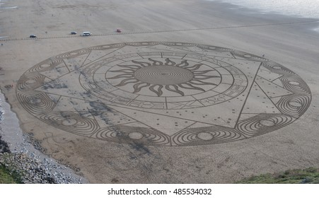 Ring of Anhur Sand Picture by Sand and Snow Artist Simon Beck on Brean Beach at Brean Down in Somerset, England, UK on the 17th September 2016.