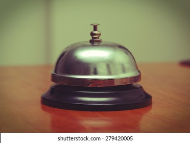 ring bell closeup on table,Vintage effect