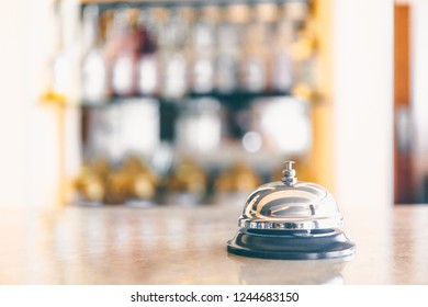 Ring bell for staff calling on the stand. Reception and bar background. Holiday and travel concept. Horizontal, selective cold toning