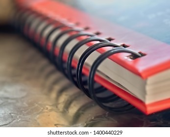 a ring binder with the ring strip in close-up, the second ring is focused and sharp, the rest soft and soft