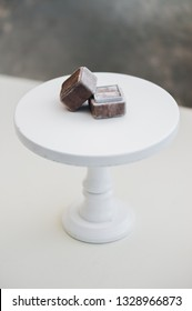 ring box on white cake stand