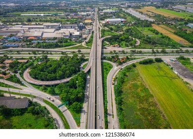 ring bridge connecting the city and freeway expressway motorway with bypass for car traffic and logistics business in Thailand aerial top view from drone camera