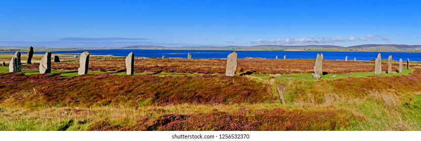 The Ring of Brodgar with Loch of Harray in the background at Mainland, Orkney Islands, Scotland, UK