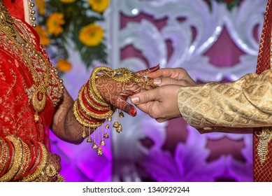 Ring Ceremony -  A Hindu wedding ritual wherein couples guve ring to each other.  Rings are worn in the Ring finger which is said to have a direct link with heart.