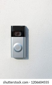Ring Intercom outdoors  on white plastered wall with call and camera, copy space.