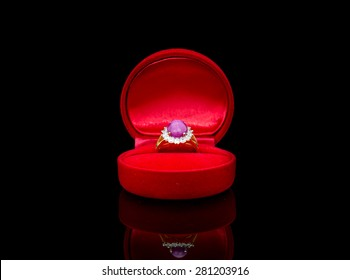Ring of the jewelry in a gift box on black background