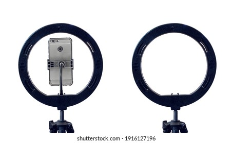 ring lamp and a smartphone on a tripod, isolated on a white background with a clipping path. inexpensive equipment for home video or photo shooting.