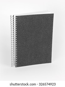Ring notebook with black cover on white background.