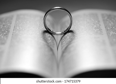 Ring on the bible with backlight form heart