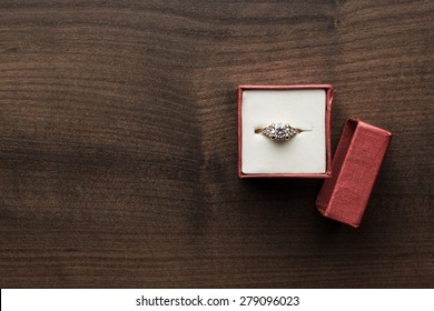 ring in the red box on wooden table
