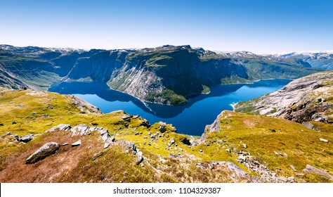 Ringedalsvatnet - blue lake in the municipality of Odda in Hordaland county, Norway. Popular tourist attraction near Trolltunga in sunny weather. Beautiful world