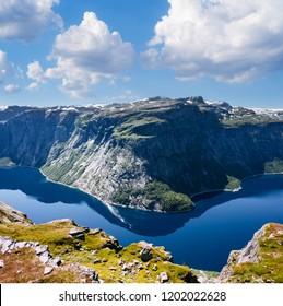 Ringedalsvatnet - mountain Lake near Trolltunga. Norwegian landscape in sunny weather