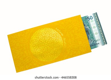 Ringgit note in a packet for Hari Raya celebration. Hari Raya is malay words which is a celebration after 30 days of fasting.(caption on packet: Fasting Day of Celebration)