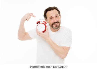 Ringing alarm clock. Personal schedule and daily regime. Alarm clock morning time. Man bearded mature guy hold clock isolated on white. Man with beard check what time is it. Time management skills.