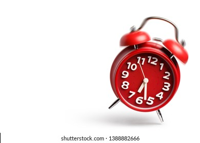 Ringing and jumping red alarm clock with copy space, isolated on white background