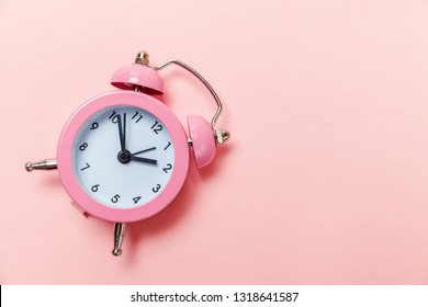 Ringing twin bell vintage classic alarm clock Isolated on pink pastel colorful trendy background. Rest hours time of life good morning night wake up awake concept. Flat lay top view copy space