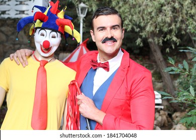 Ringmaster and clown in the circus
