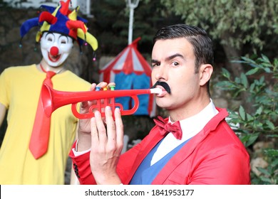 Ringmaster playing the trumpet in the circus