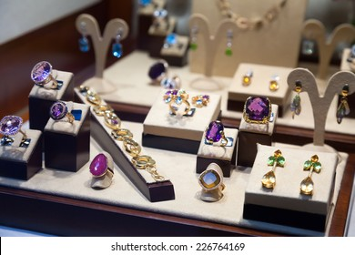 Rings with gems on showcase of jewelry store