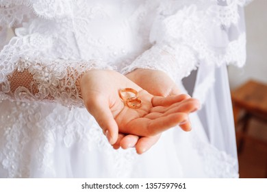Rings in the hand of the bride
