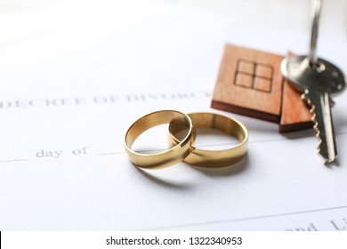 Rings with key from house and decree of divorce, closeup