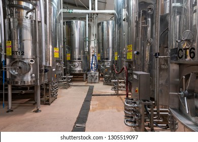 Ringwood, England - October 26, 2018: Production of beer at the Ringwood Brewery with stainless steel barrels and pipes.