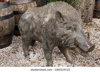 Ringwood, England - October 26, 2018: Boar of the Ringwood Brewery with two wooden barrels .