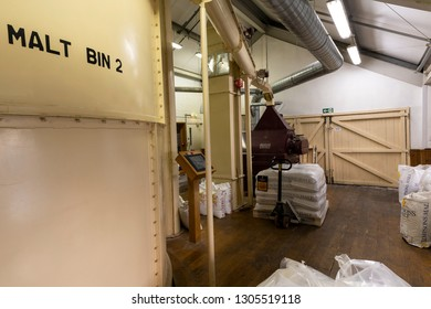 Ringwood, England - October 26, 2018: Production of beer at the Ringwood Brewery with malt barrels, pipes and sacks of malt.