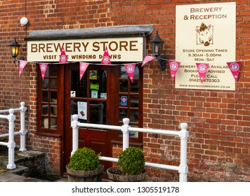Ringwood, England - October 26, 2018: Store of the Ringwood Brewery with small flags, lamp and information signs.