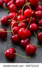 Rinsed fresh cherries background close up.