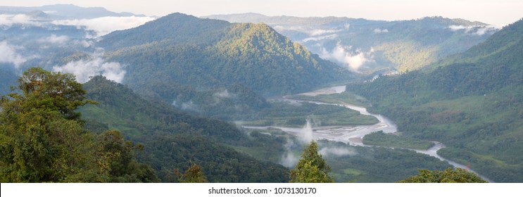 The Rio Abanico Valley, Ecuador, with misty cloudforest covered hillsides. On the Amazonian slopes of the Andes in Morona Santiago province