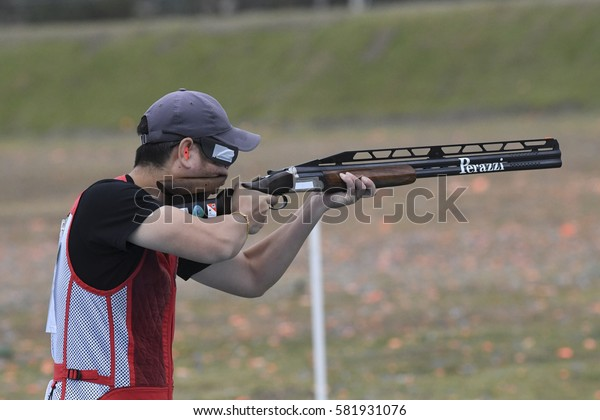 Rio, Brazil - august 10, 2016: HU Binyuan (CHN) during Double Trap Men at Olympic Games 2016 in Olympic Shooting Centre, Deodoro
