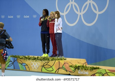 Rio, Brazil - august 13, 2016: Simone Manuel (L) (USA), Pernille Blume (DEN) (C) and Aliaksandra Herasimenia (R) (BLR) during medal ceremony after women's 50 metre freestyle of the Rio 2016 Olympics