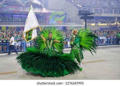 Rio, Brazil - february 12, 2018: Samba School Imperatriz Leopoldinense perform at Marques de Sapucai known as Sambodromo, for the Carnival Samba Parade competition. couple of master room and door flag