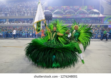 Rio, Brazil - february 12, 2018: Samba School Imperatriz Leopoldinense perform at Marques de Sapucai known as Sambodromo, for the Carnival Samba Parade competition. couple of master room and door flag