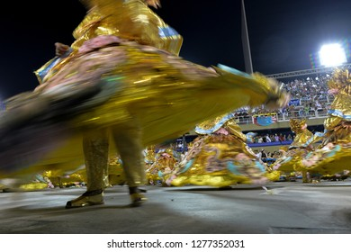 Rio, Brazil - february 12, 2018: Samba School Beija Flor perform at Marques de Sapucai known as Sambodromo, for the Carnival Samba Parade competition. Baiana in motion Blur